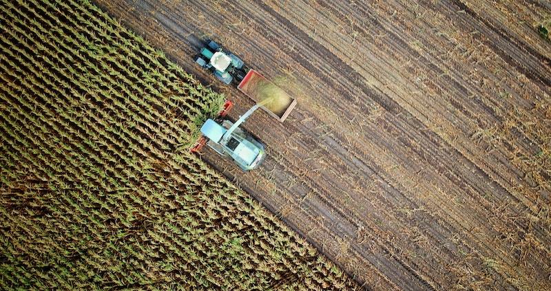 Aerial photo of tractor harvesting on farmland