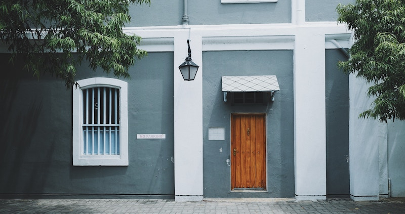 A front door of an apartment building