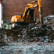A bulldozer moving construction waste