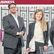 Photo from The West featuring Jocelyne Boujos, Nicholas van Hattem, Lea Hiltenkamp and Jack Carroll standing in a board room in front of a wall of photos of past and current presidents of the Law Society of Western Australia.