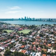 View of Perth skyline on a sunny day with the river and suburbs in the foreground