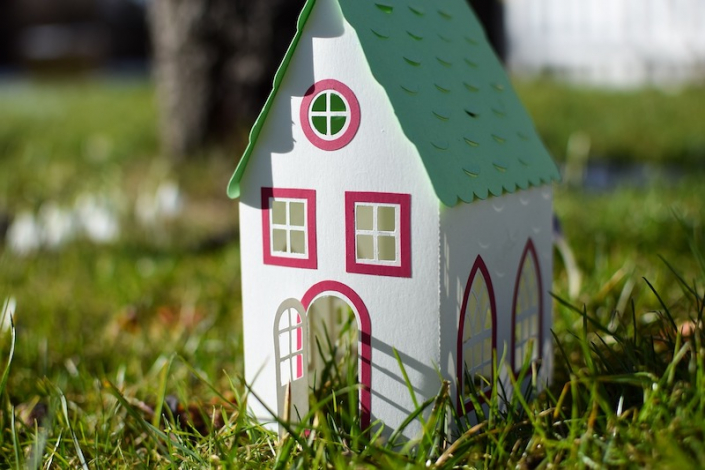 Image of a paper house on grass